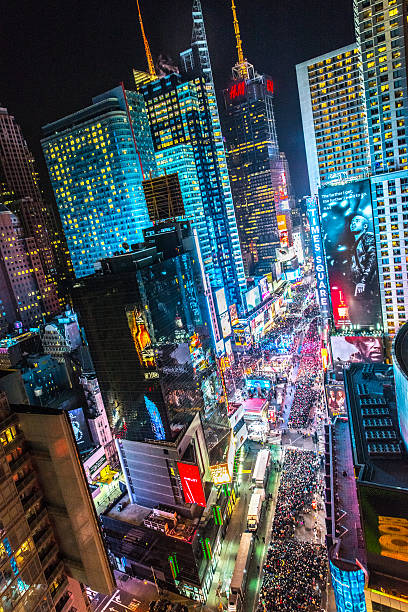 crowds celebrating new year on times square, nyc - times square stock photos and pictures