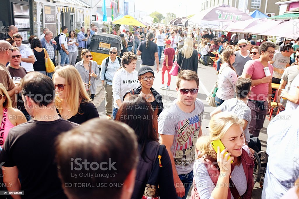 Crowds enjoying a street festival in a Cape Town suburb stock photo