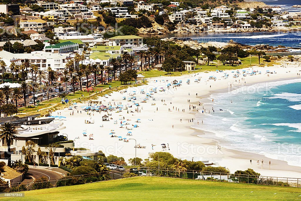 Crowds enjoying Camps Bay, Cape Town on idyllic summer day stock photo