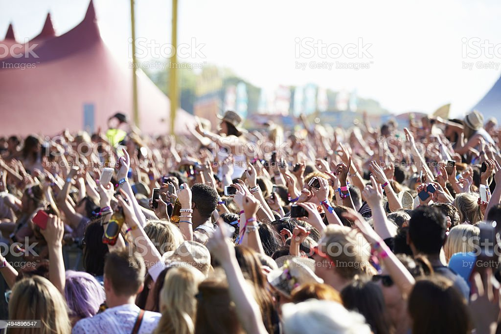 Crowds Enjoying Themselves At Outdoor Music Festival Crowds Enjoying Themselves At Outdoor Music Festival Hands In The Air Music Festival Stock Photo