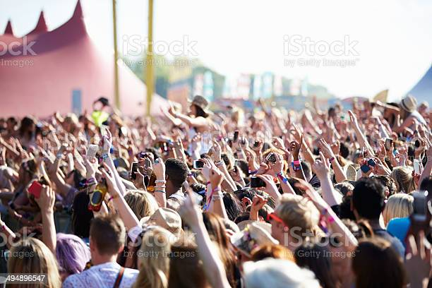 Crowds Enjoying Themselves At Outdoor Music Festival Stock Photo - Download Image Now