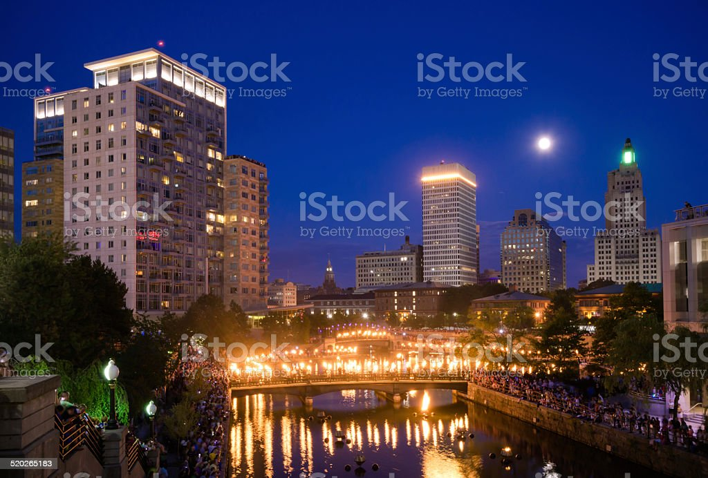 Crowds gather along Woonasquatucket river in Providence, RI stock photo