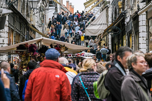 Crowds gather at the foot of Rialto Bridge, Venice, Italy stock photo