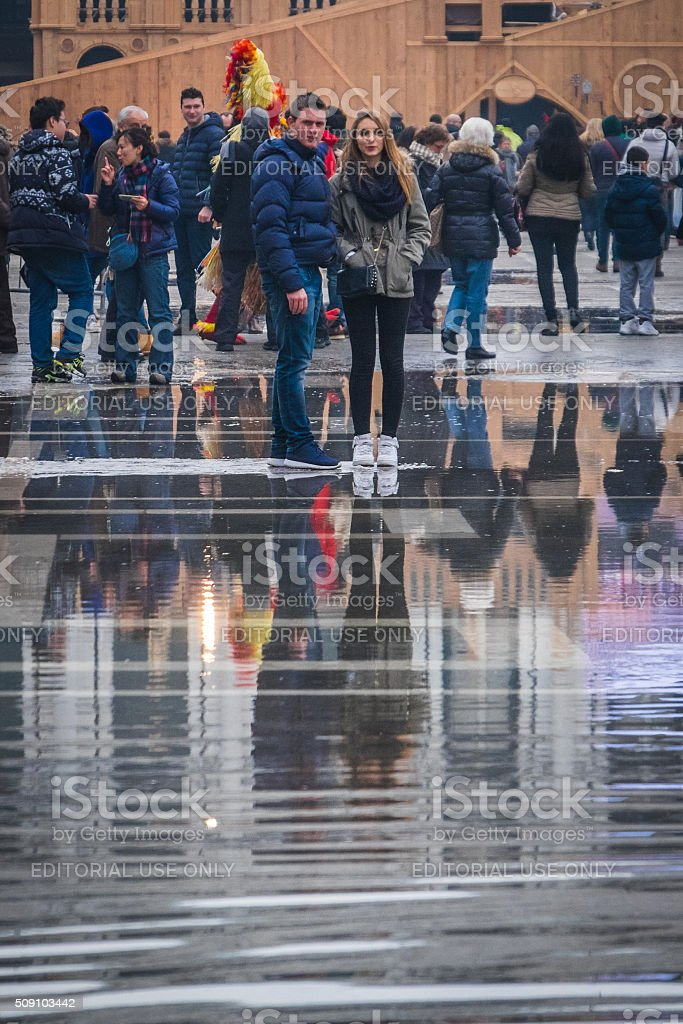 Crowds gather in wet St Mark's Square for Mardi Gras stock photo