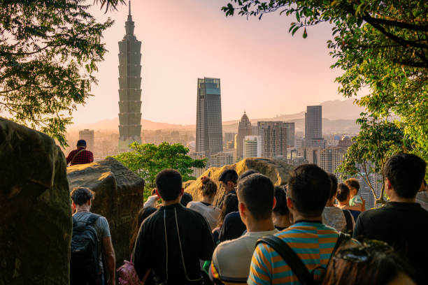 Crowds gathering to watch the Taipei sunset stock photo