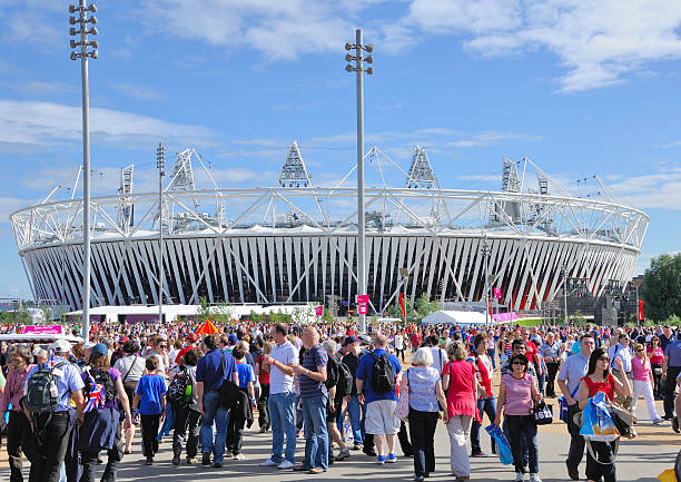 """Crowds head for Olympic Stadium at London 2012 """"Stratford, London, England - August 3rd, 2012: Crowds gather in anticipation of the 1st day of Athletics at the Olympic Stadium, Stratford in London, England for the London 2012 Olympic Games."""" 2012 stock pictures, royalty-free photos & images"""
