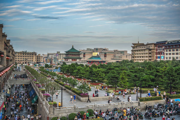 Crowds in busy Xian town centre square stock photo