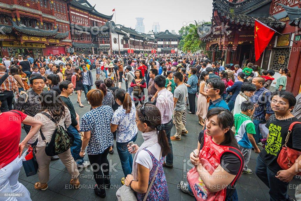 Crowds of Chinese tourists at Yuyuan Garden shops Shanghai China stock photo