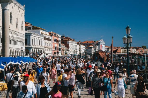 crowds of people at street near to st. mark's square, piazza san marco, doge's palace and on ponte della paglia bridge. italy, travel concept - della stock pictures, royalty-free photos & images
