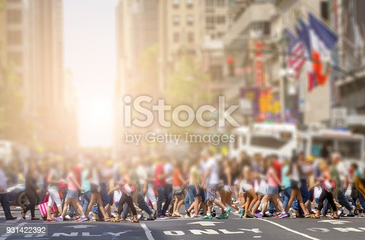 813211754 istock photo Crowds of people in Midtown Manhattan in New York City 931422392