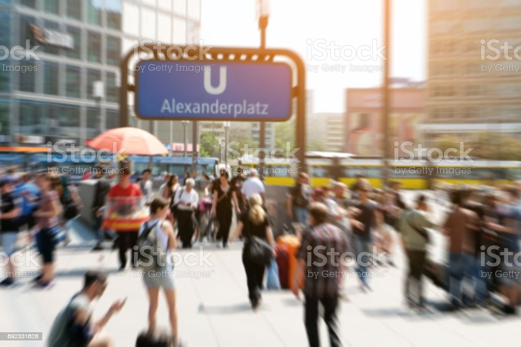 crowds of people in motion blur - Alexanderplatz in Berlin city stock photo