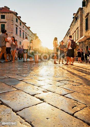 istock Crowds of people in Stradun Street in Dubrovnik sunset Croatia 694937642