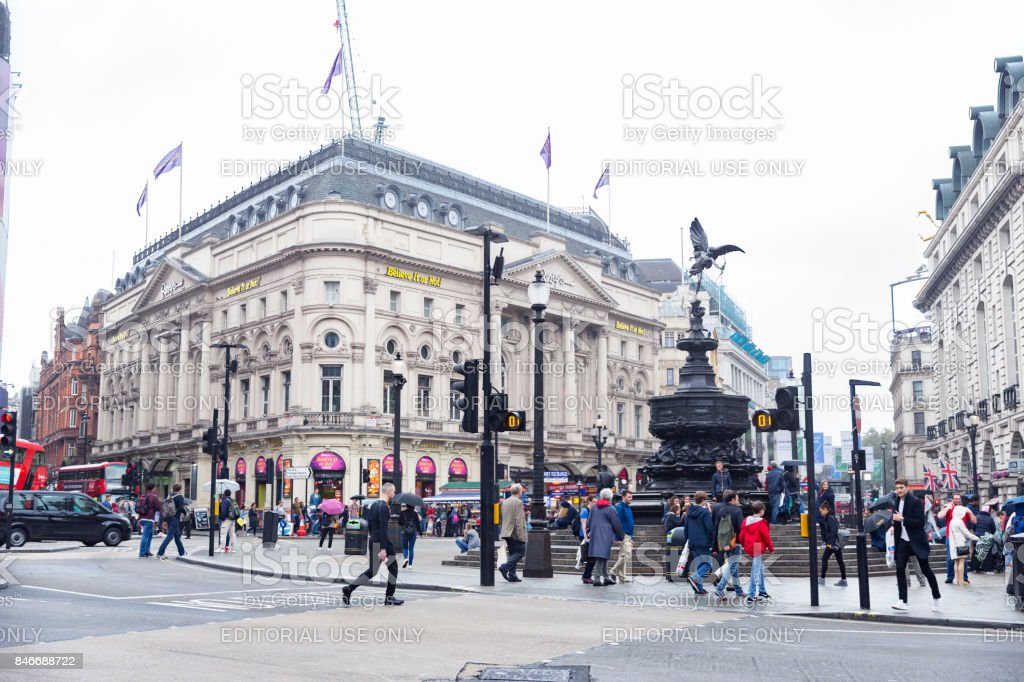 Crowds of people near the Statue of Eros at Piccadilly Circus on a regular day. stock photo