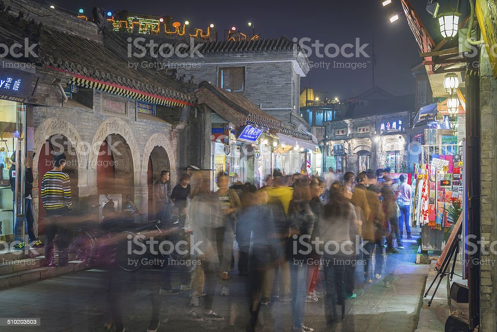 Crowds of people night shopping in Beijing alleyways China stock photo