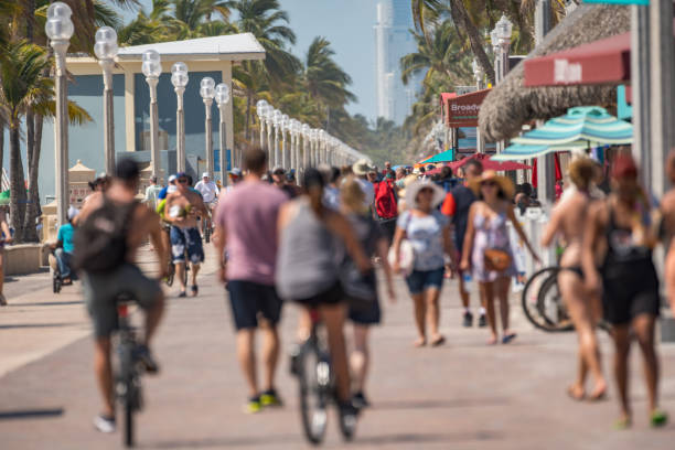 crowds of people on the beach memorial day - memorial day weekend стоковые фото и изображения