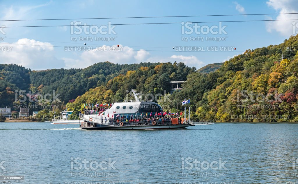 Crowds of people use a ferry to visit Nami Island in South Korea stock photo