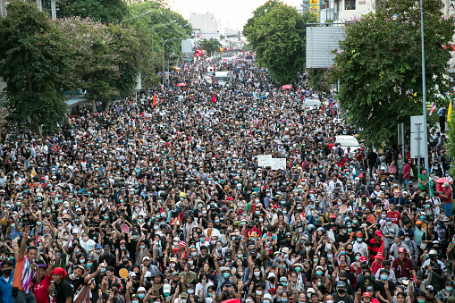 Crowds of protesters march in Bangkok, Thailand