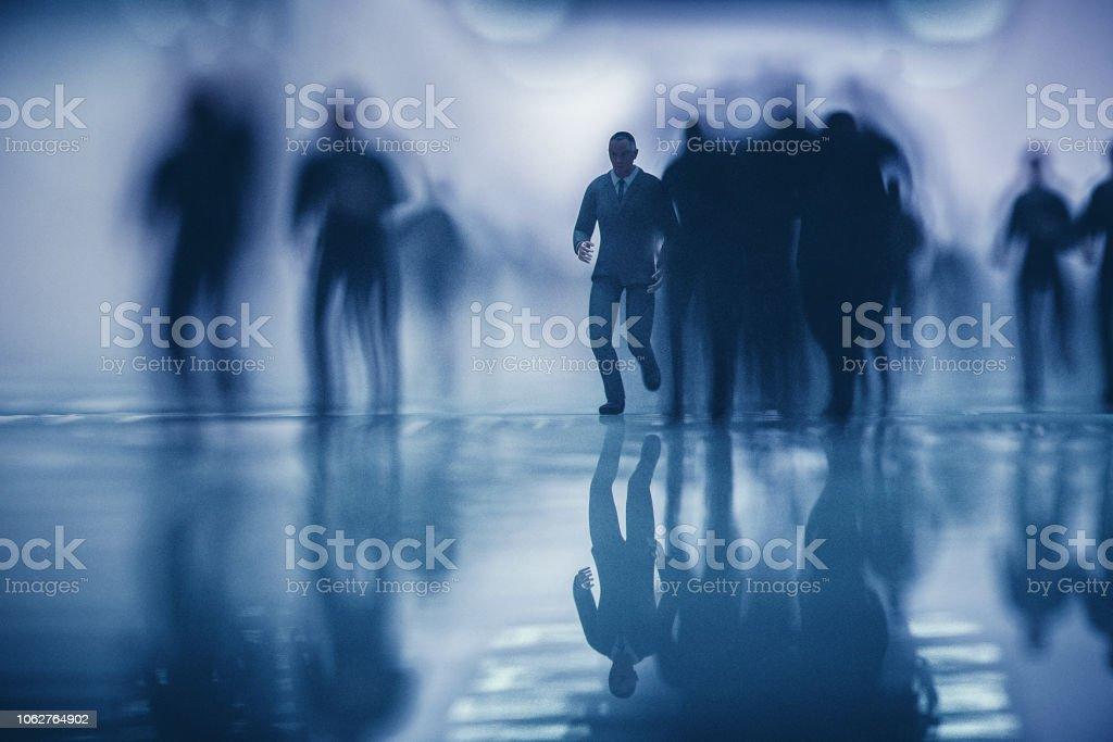 Crowds of running business in underground passage.