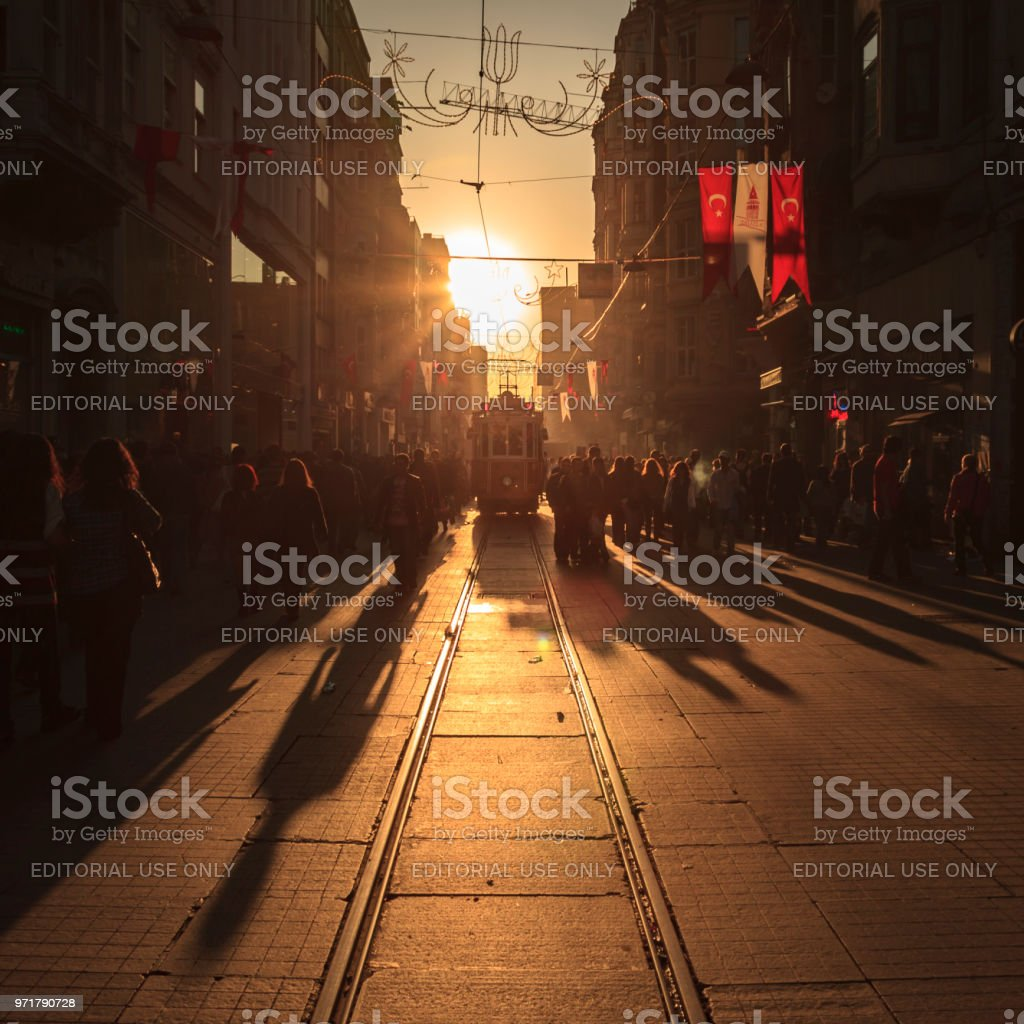 Crowds of shoppers and a tram on Istiklal Avenue in Istanbul, Turkey stock photo