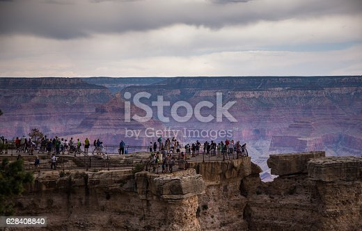 Crowds of sightseers looking over the rim of the Grand Canyon. Still taken from time lapse video #594757676.