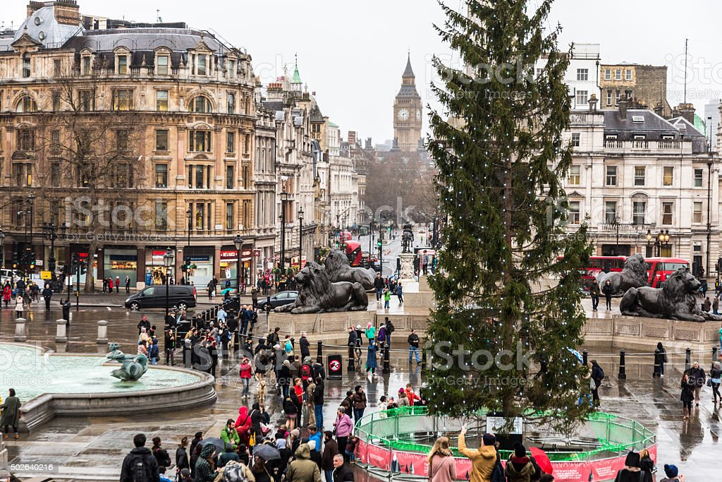 Crowds of Tourists by the Christmas Tree in Trafalgar Square stock photo