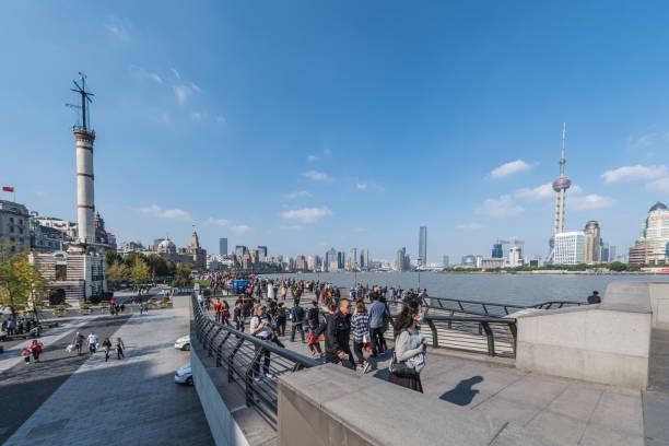 Crowds of tourists walking The Bund in Shanghai stock photo