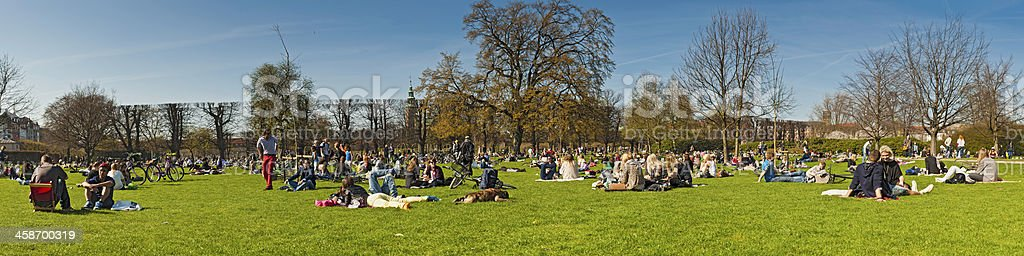 Crowds of young people enjoying sunshine in park royalty-free stock photo