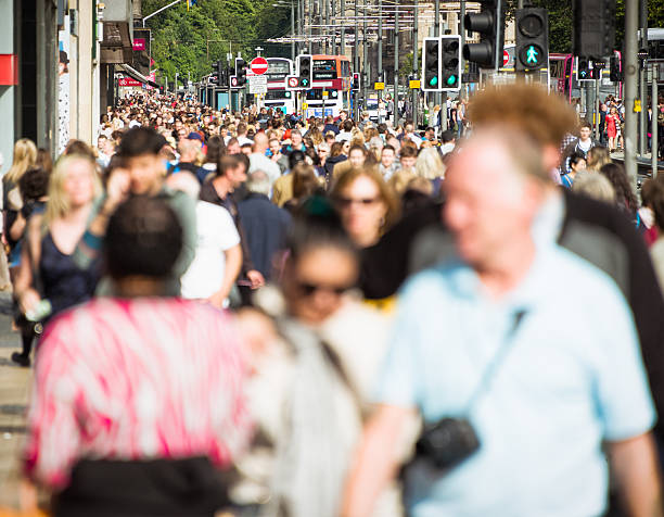 Crowds on busy British shopping street in summer Edinburgh's Princes Street busy with shoppers and tourist crowds during August. princes street edinburgh stock pictures, royalty-free photos & images