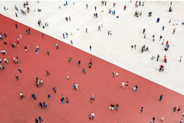 Crowds standing on two separated zones stock photo