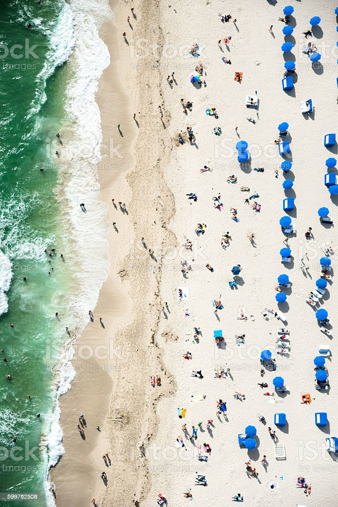 crowds sunbathing on the beach in miami stock photo