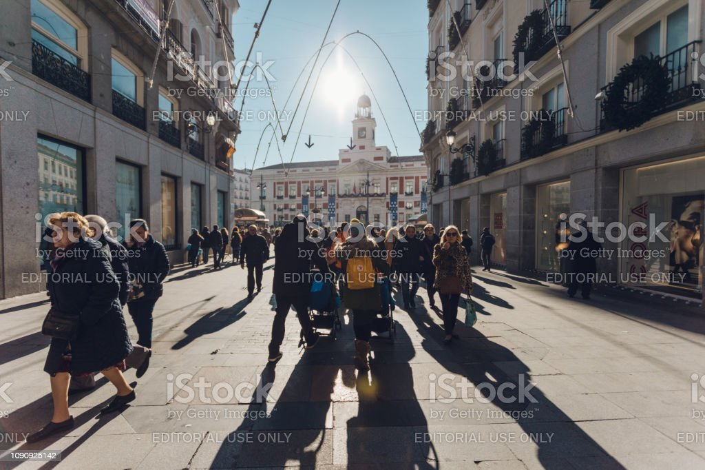 crowds walking through the city stock photo