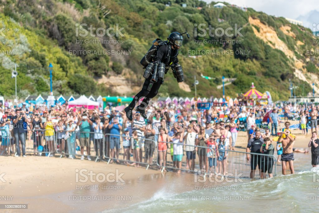 Crowds watch a Jet Suit display at the Bournemouth Air Festival stock photo