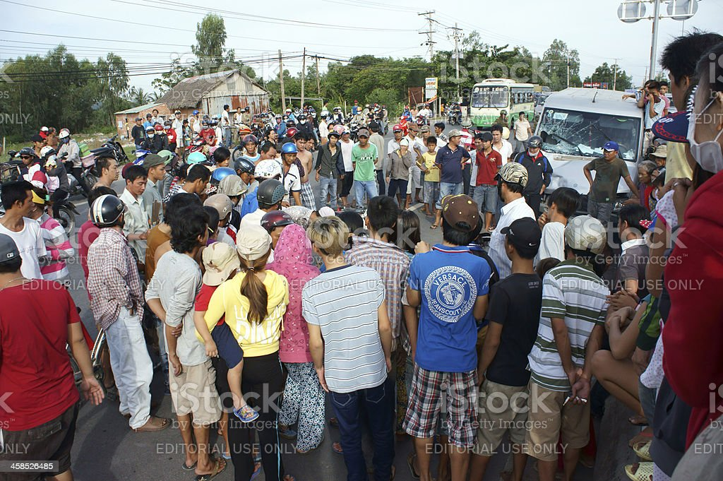 Crowds with curiousness muster to see traffic accident royalty-free stock photo