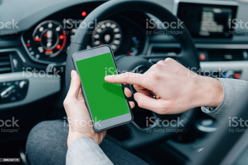 Crowdsourced taxi app on smartphones for new drivers stock photo