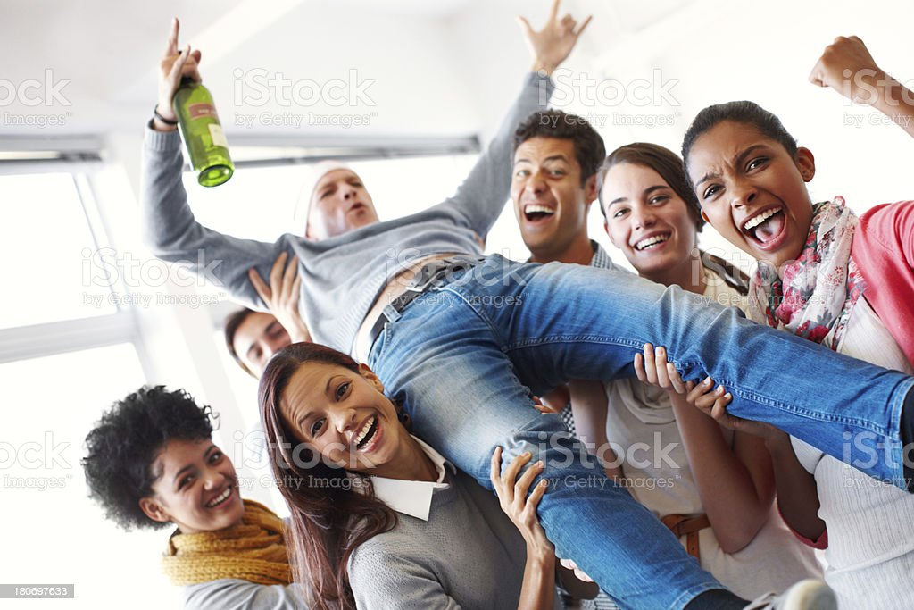 Crowdsurfing his colleagues stock photo