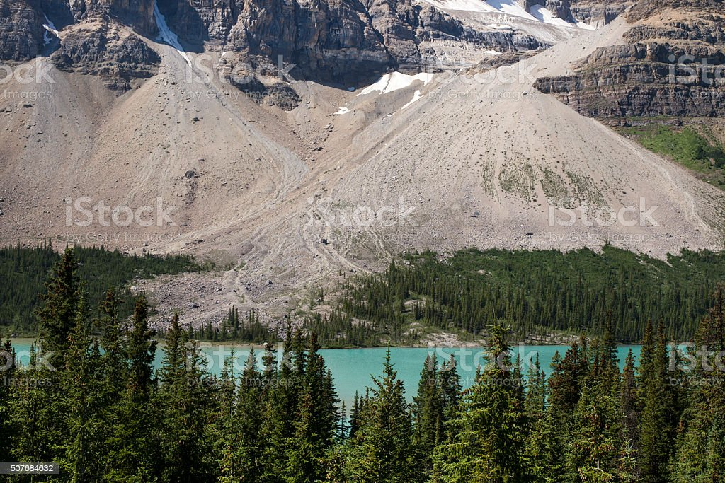 crowfoot mountain, glacier lake and forest in Banff, Alberta stock photo