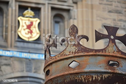 Crown in front of gate to Edinburgh Castle, Royal Stuart coat of arms in background, Scotland, United Kingdom, sunny day