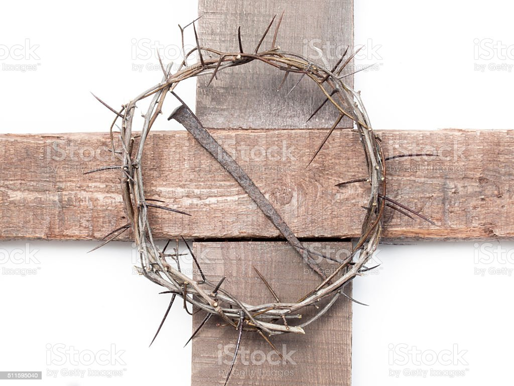 Crown of thorns and a nail on the Holy Cross stock photo