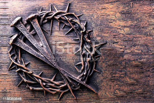 Crown of thorns and nails engraved on stone