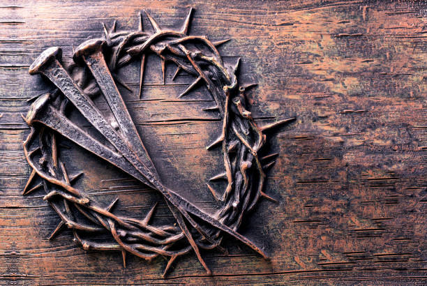 Crown of thorns and nails engraved on stone stock photo