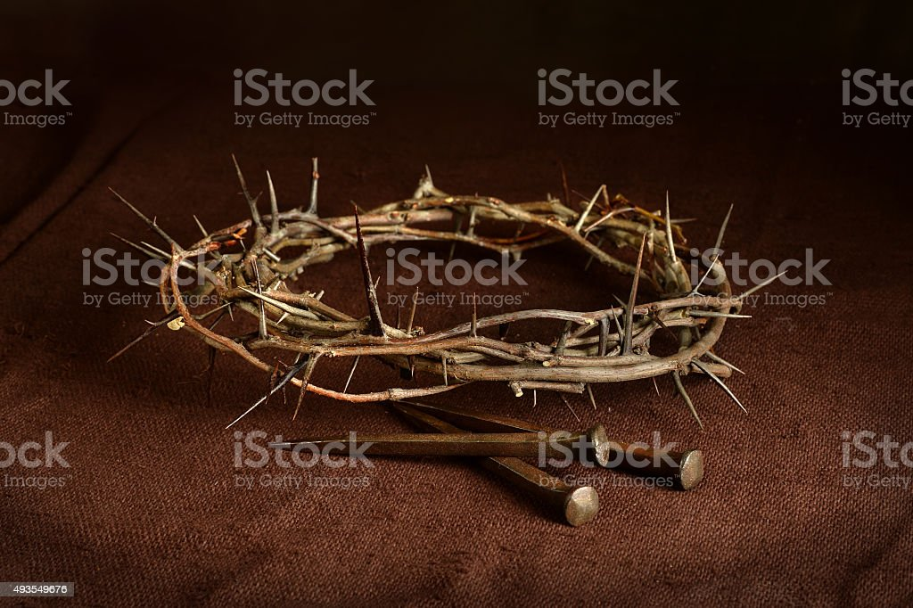 Crown of Thorns and Nails on Cloth stock photo
