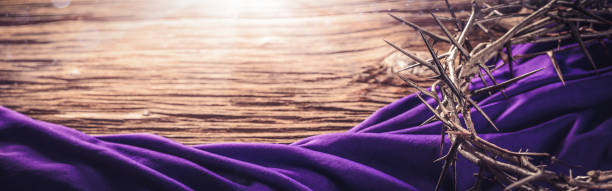 Crown Of Thorns And Purple Robe Crown Of Thorns And Purple Robe On Wooden Floor With Sunlight - Crucifixion Of Jesus Christ good friday stock pictures, royalty-free photos & images