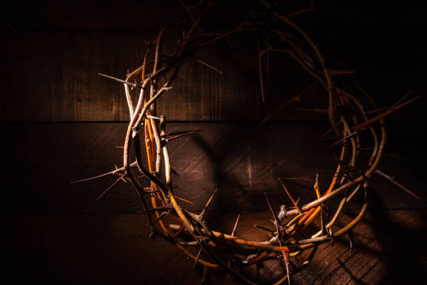 A crown of thorns on a wooden background. Easter Theme stock photo