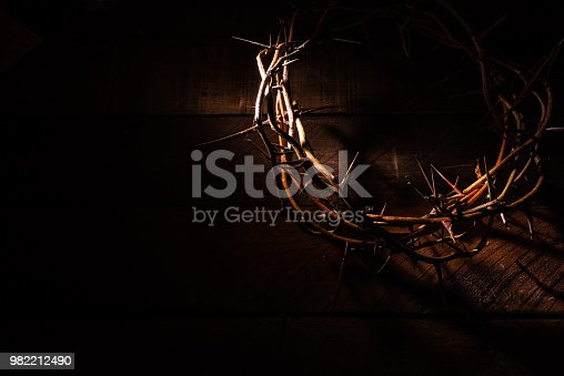 istock A crown of thorns on a wooden background. Easter Theme 982212490