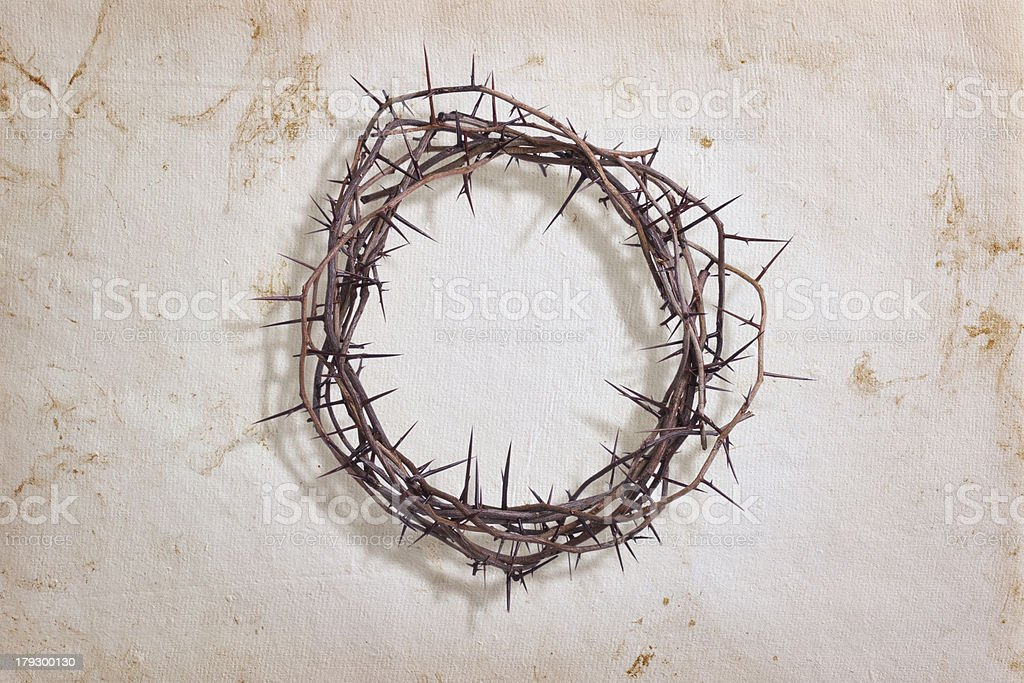 Crown of thorns on textured paper stock photo