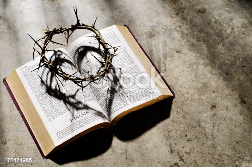 Crown of thorns on a bible with heart shape shadow.  Please see my portfolio for other religious related images.