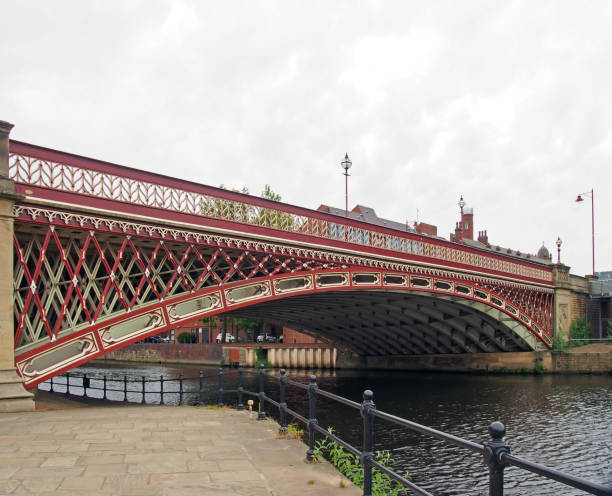crown point bridge crossing the river aire in leeds a single span fretted cast iron construction opened in 1842 taken from the riverside path stock photo