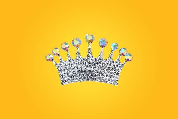 Crown princess isolated on yellow background. Jewel wedding accessory. stock photo