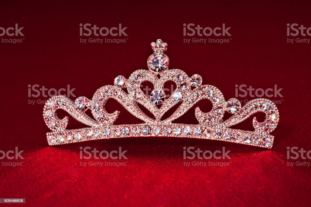 Crown shape on red background stock photo