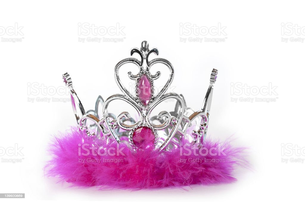 A crown with pink fur and jewels stock photo